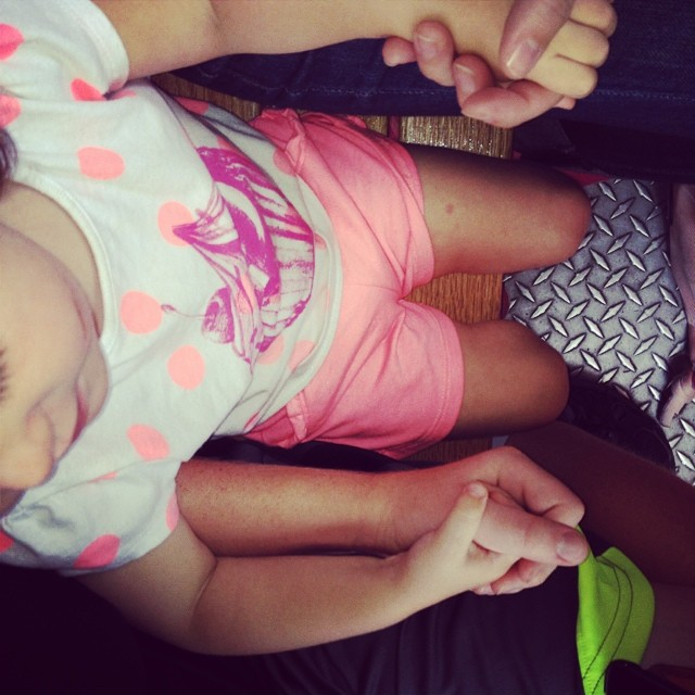 Because holding two hands is definitely better than one! Holding on to mama and big brother during the train ride :)