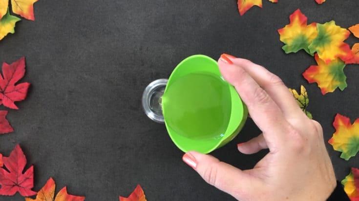 Pouring castile soap into foaming hand soap recipe