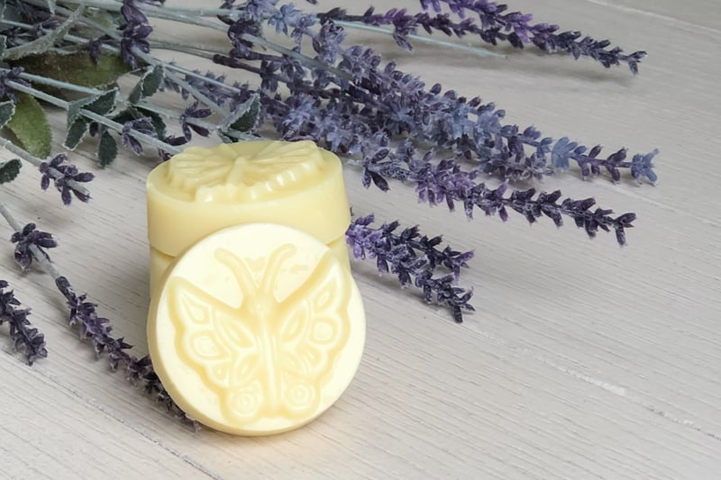 homemade natural lotion bar on a table with lavender