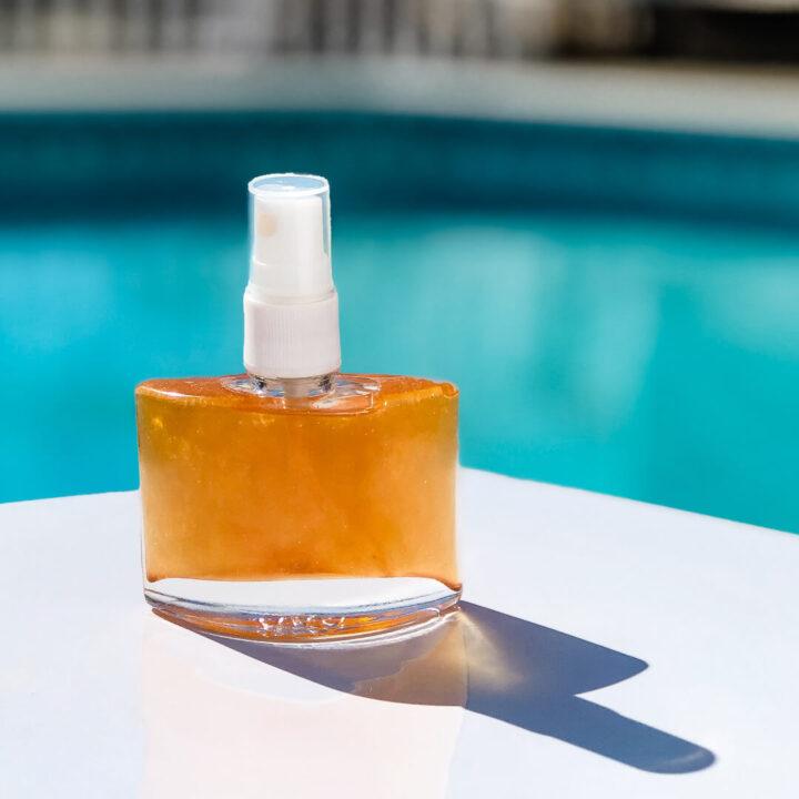 DIY Shimmer Body Oil by Pool