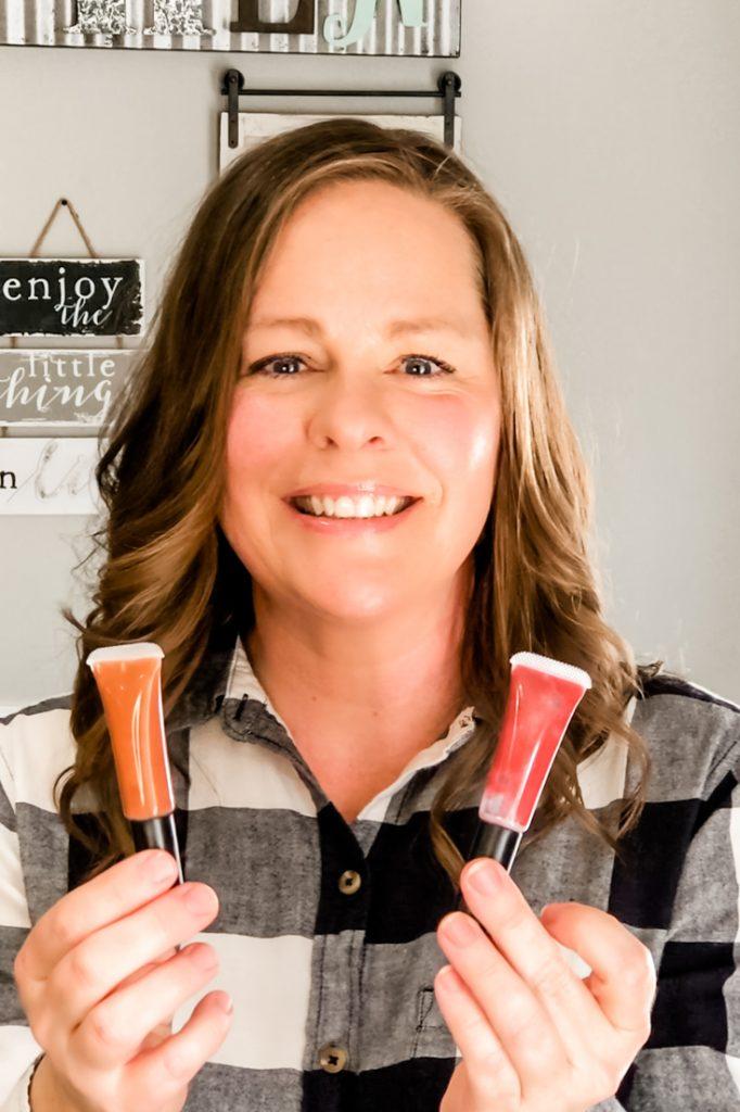 Mindy Benkert holding 2 tubes of homemade lip gloss